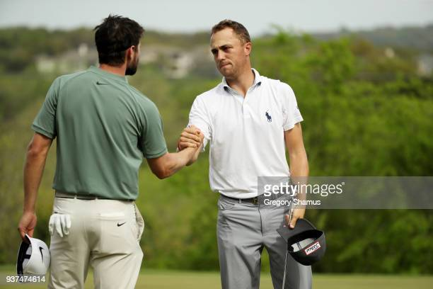 Justin Thomas of the United States shakes hands with Kyle Stanley of the United States after defeating him 21 on the 17th green during the...