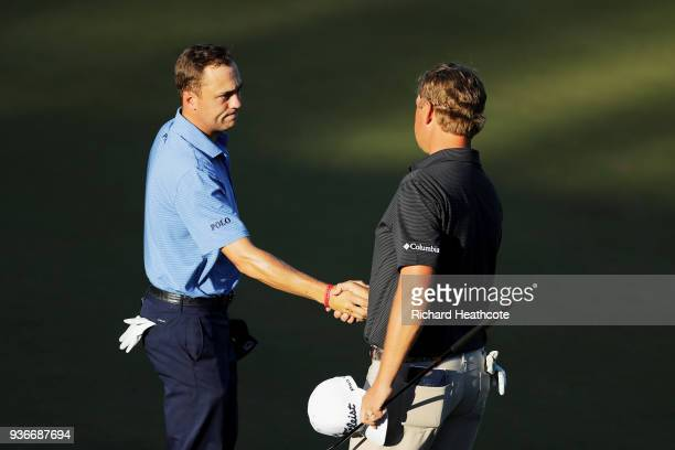 Justin Thomas of the United States shakes hands with Patton Kizzire of the United States after defeating him 31 on the 17th green during the second...