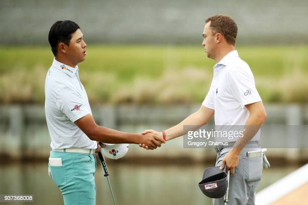 Justin Thomas of the United States shakes hands with Si Woo Kim of South Korea after defeating him 65 on the 13th green during the fourth round of...