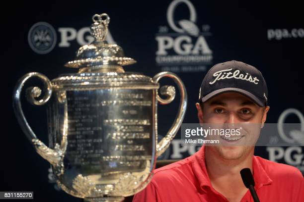 Justin Thomas of the United States speaks to the press with the Wanamaker Trophy after winning the 2017 PGA Championship during the final round at...