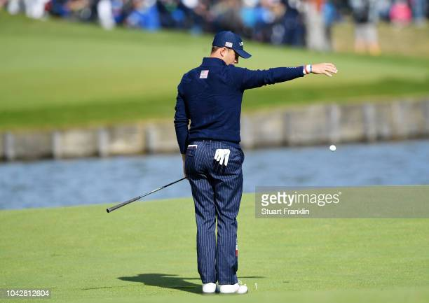 Justin Thomas of the United States takes a drop on the 15th during the morning fourball matches of the 2018 Ryder Cup at Le Golf National on...