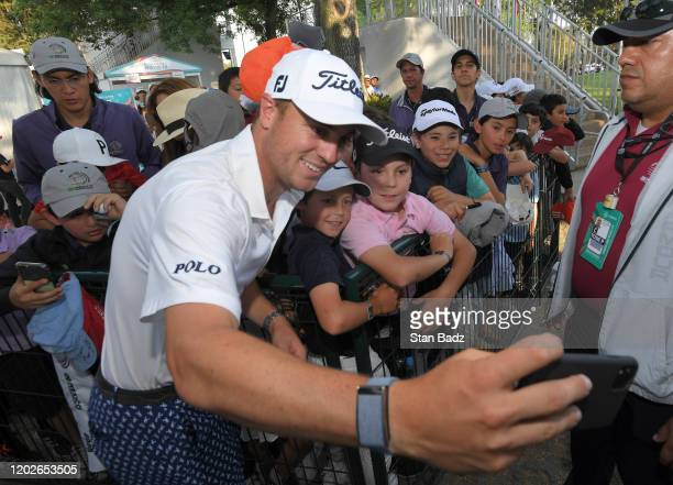 Justin Thomas of the United States takes a selfie with fans after the third round of the World Golf Championships-Mexico Championship at Club de Golf...