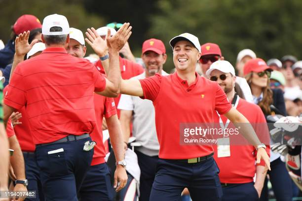 Justin Thomas of the United States team and other members of the United States team congratulate Matt Kuchar of the United States team after he...