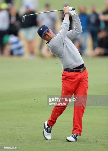 Justin Thomas of the United States Team plays his second shot on the 15th hole in his match with Rickie Fowler in their match against Marc Leishman...