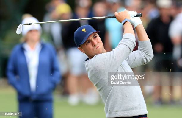 Justin Thomas of the United States Team plays his third shot on the 15th hole in his match with Rickie Fowler in their match against Marc Leishman...