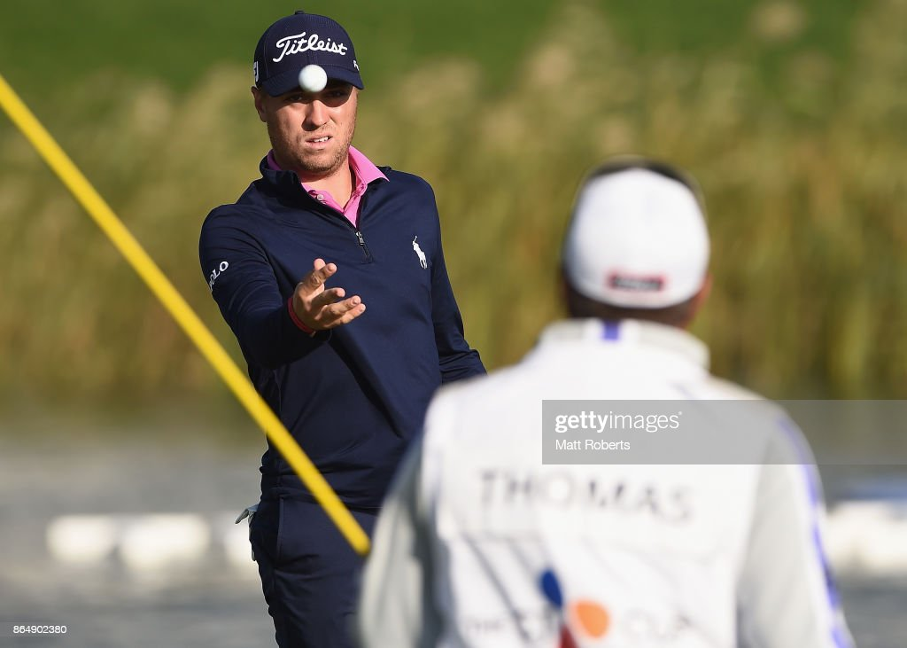 Justin Thomas of the United States throws the ball to his caddie during the final round of the CJ Cup at Nine Bridges on October 22, 2017 in Jeju, South Korea.