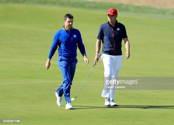 Justin Thomas of the United States walks to his second shot on the 10th hole in his match against Rory McIlroy of the European Team during singles...