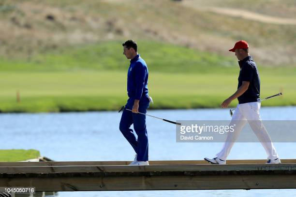 Justin Thomas of the United States walks top the green on the 15th hole in his match against Rory McIlroy of the European Team during singles matches...