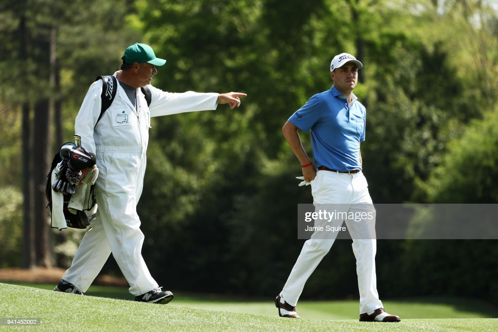 Justin Thomas of the United States walks with caddie Jimmy Johnson during a practice round prior to the start of the 2018 Masters Tournament at Augusta National Golf Club on April 3, 2018 in Augusta, Georgia.