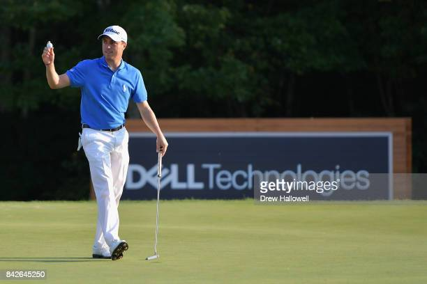 Justin Thomas of the United States waves to the crowd after making par on the 18th green to win the Dell Technologies Championship at TPC Boston on...