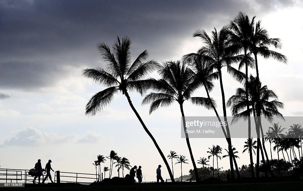 Justin Thomas of the United States, Zach Johnson of the United States and Justin Rose of England walk to the 17th green during the final round of the Sony Open In Hawaii at Waialae Country Club on January 15, 2017 in Honolulu, Hawaii.