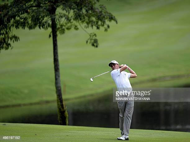 Justin Thomas of the US hits the ball on the 10th fairway during the final round of 2015 CIMB Classic golf tournament at the Kuala Lumpur Golf and...