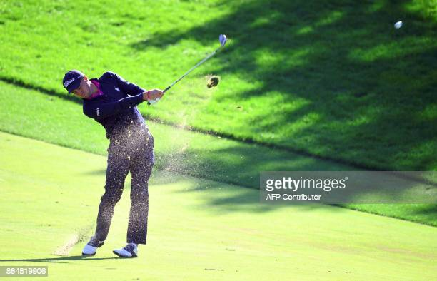 Justin Thomas of the US plays his second shot on the 1st hole during the final round of the CJ Cup at Nine Bridges in Jeju Island on October 22 2017...