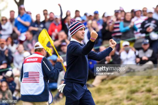 Justin Thomas of the US Team celebrates after Daniel Berger made a birdie putt on the 11th hole green during Saturday afternoon FourBall matches in...