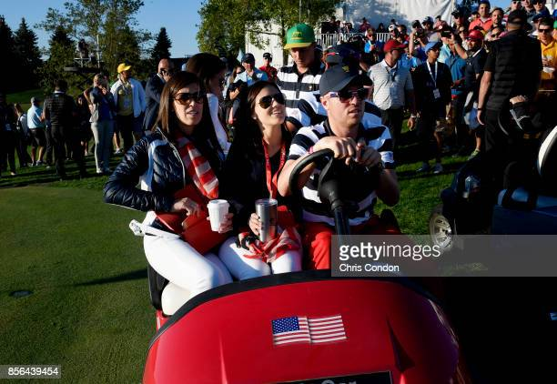 Justin Thomas of the US Team drives a golf cart during the Sunday singles matches at the Presidents Cup at Liberty National Golf Club on October 1 in...
