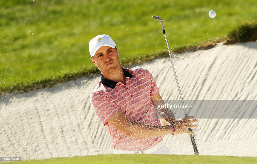 Justin Thomas of the U.S. Team makes a shot from a bunker on the 14th hole during Friday four-ball matches of the Presidents Cup at Liberty National Golf Club on September 29, 2017 in Jersey City, New Jersey.