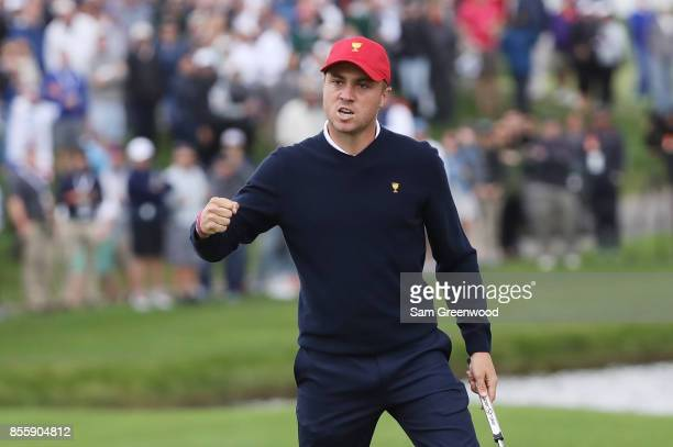 Justin Thomas of the US Team reacts on the 17th green during Saturday foursome matches of the Presidents Cup at Liberty National Golf Club on...