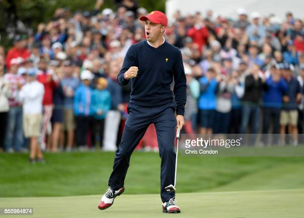 Justin Thomas of the US Team reacts to a parsaving putt to halve the match on the 18th hole during the Saturday morning foursomes matches during the...