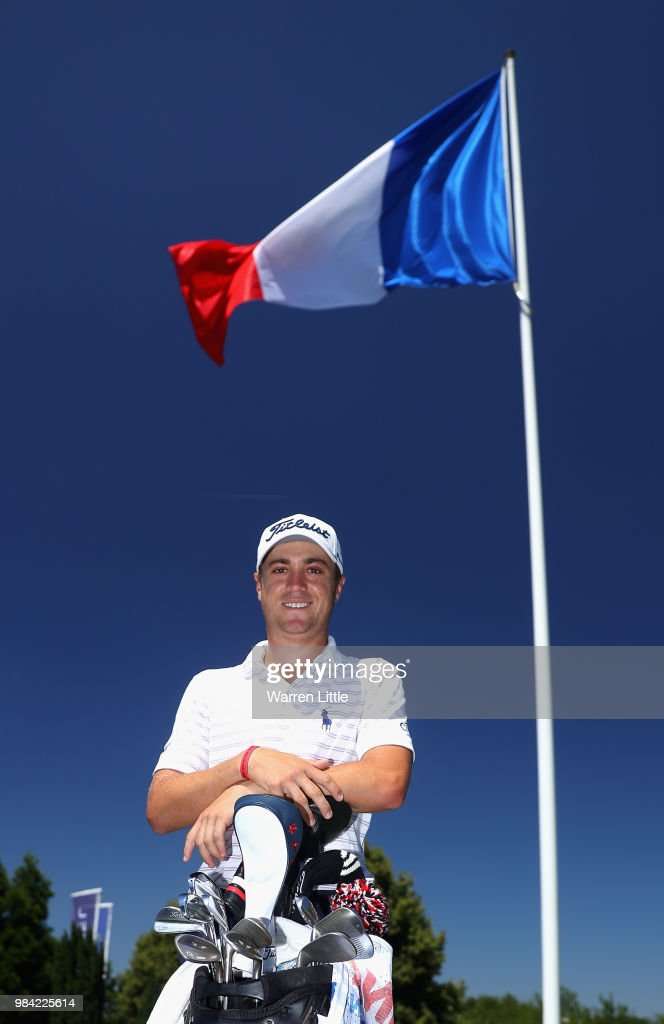 Justin Thomas of the USA poses for a picture with the French flag ahead of the HNA Open de France at Le Golf National on June 26, 2018 in Paris, France.