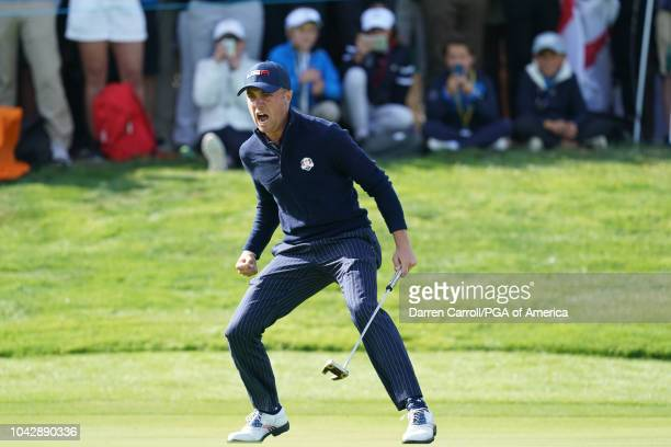 Justin Thomas of USA celebrates after making his putt on the 17th hole to win the match during the morning fourball matches of the 2018 Ryder Cup at...