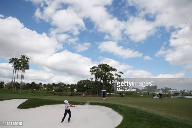 Justin Thomas plays a shot from a bunker on the third hole during the first round of the Honda Classic at PGA National Resort and Spa on February 28...