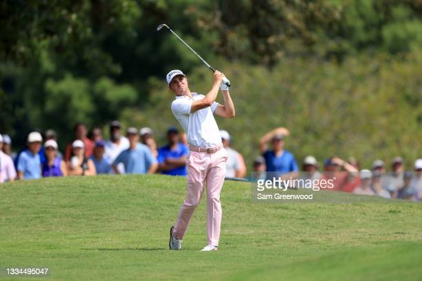 Justin Thomas plays a shot on the first hole during the final round of the World Golf Championship-FedEx St Jude Invitational at TPC Southwind on...