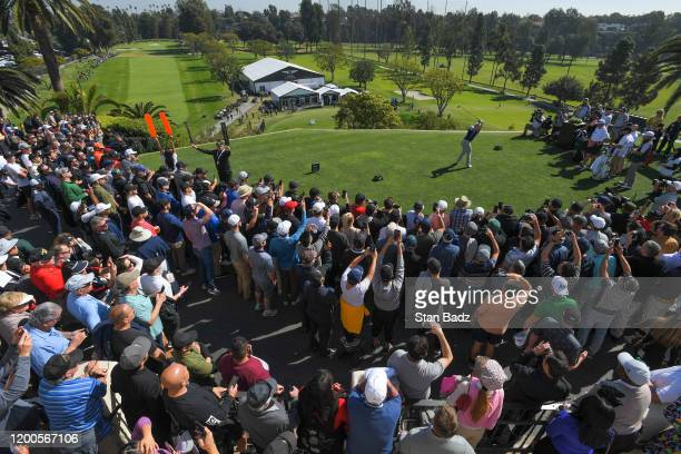 Justin Thomas plays a tee shot on the first hole during the first round of the Genesis Invitational at Riviera Country Club on February 13 2020 in...