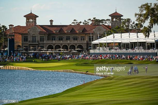 Justin Thomas plays his approach shot near the water on the 18th hole fairway during the final round of THE PLAYERS Championship on the Stadium...
