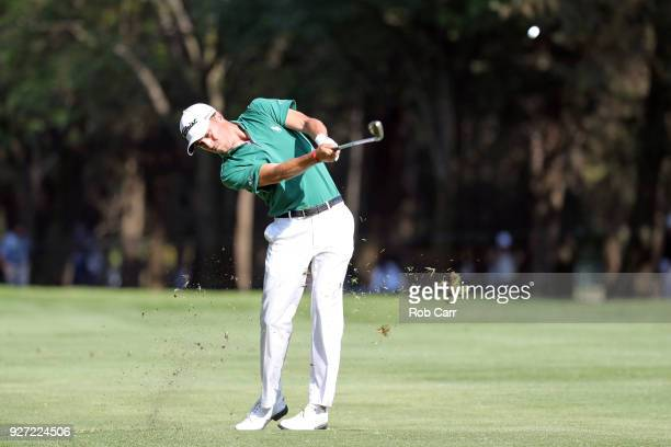 Justin Thomas plays his second shot to make an eagle from the 18th fairway during the final round of World Golf ChampionshipsMexico Championship at...