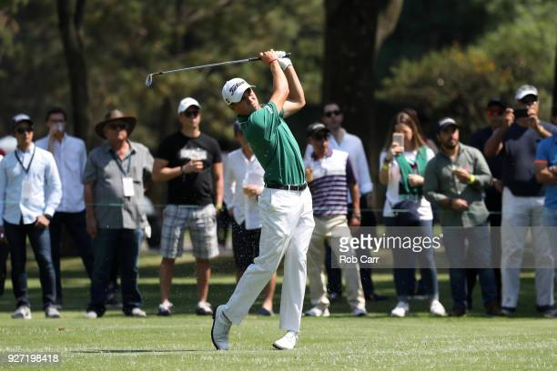 Justin Thomas plays his second shot to the ninth green during the final round of World Golf ChampionshipsMexico Championship at Club De Golf...