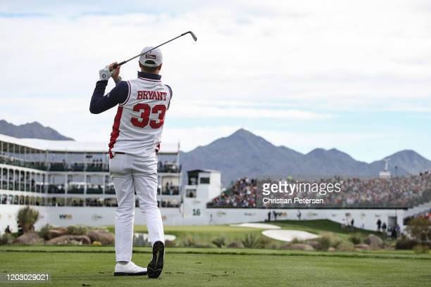Justin Thomas plays his shot from the 16th tee while wearing a replica high school jersey of former NBA player Kobe Bryant during the first round of...