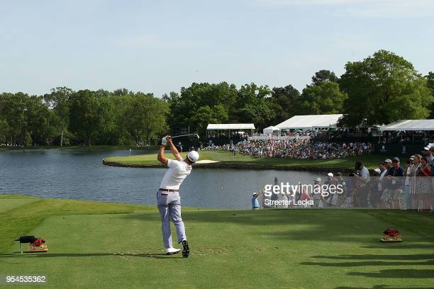 Justin Thomas plays his tee shot on the 17th hole during the first round of the 2018 Wells Fargo Championship at Quail Hollow Club on May 3, 2018 in...