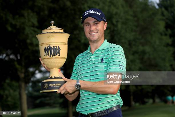 Justin Thomas poses with the Gary Player Cup after winning the World Golf Championships-Bridgestone Invitational at Firestone Country Club South...