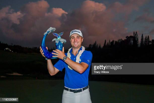 Justin Thomas poses with the trophy after winning a three-hole playoff during the final round of the Sentry Tournament of Champions on the Plantation...