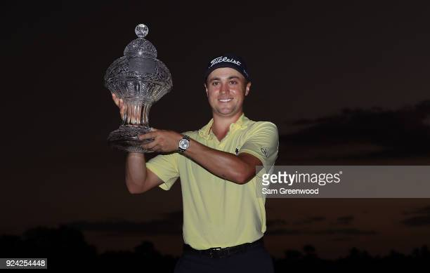 Justin Thomas poses with the trophy after winning The Honda Classic at PGA National Resort and Spa on February 25 2018 in Palm Beach Gardens Florida