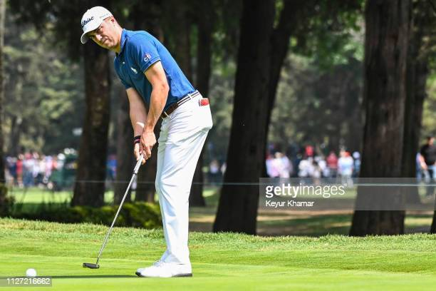 Justin Thomas putts on the third hole green during the final round of the World Golf Championships Mexico Championship at Club de Golf Chapultepec on...