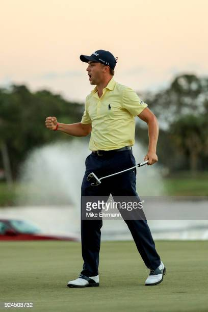 Justin Thomas reacts after a putt on the 18th green during the first playoff hole in the final round of the Honda Classic at PGA National Resort and...