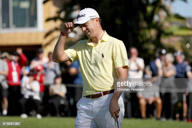 Justin Thomas reacts after making eagle on the first green during the third round of the Genesis Open at Riviera Country Club on February 17 2018 in...