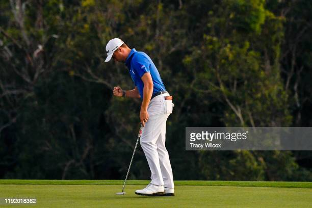 Justin Thomas reacts after sinking a birdie putt on the third playoff hole during the final round of the Sentry Tournament of Champions on the...