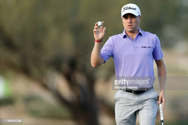 Justin Thomas reacts following a putt on the 15th green during the second round of the Waste Management Phoenix Open at TPC Scottsdale on February 01...