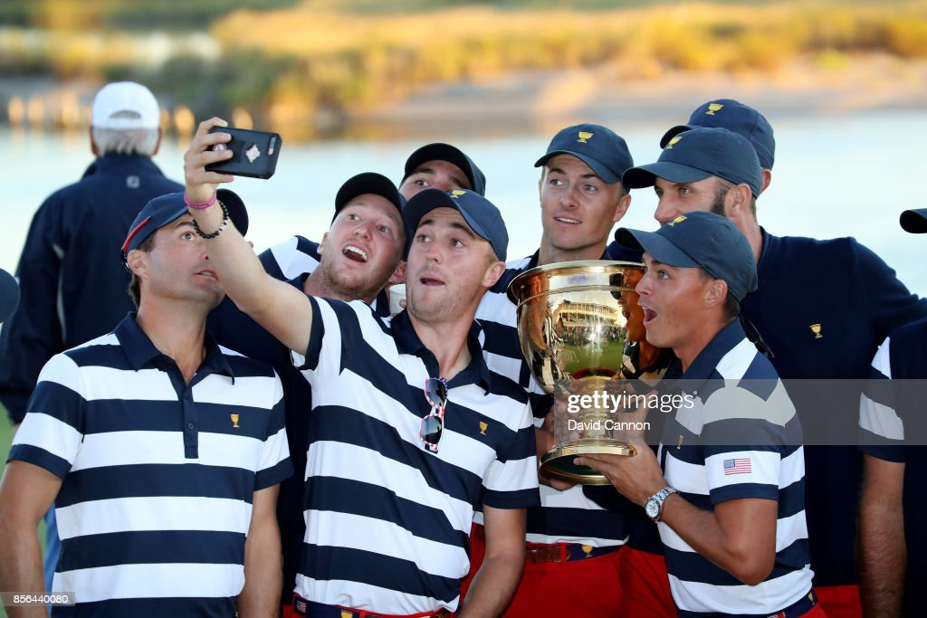 Justin Thomas (left of trophy), Rickie Fowler (holding trophy) Jordan Spieth (centre) and other members of the victorious United States team enjoy taking a 'selfie' with the Presidents Cup after their 19-11 victtory during the final day singles matches matches in the 2017 Presidents Cup at the Liberty National Golf Club on October 1, 2017 in Jersey City, New Jersey.