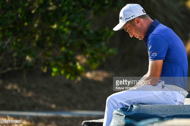 Justin Thomas sits and gets emotional following his one stroke victory in the final round of THE PLAYERS Championship on the Stadium Course at TPC...