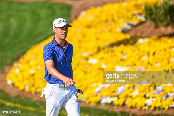 Justin Thomas smiles on the 13th hole during the final round of THE PLAYERS Championship on the Stadium Course at TPC Sawgrass on March 14 in Ponte...