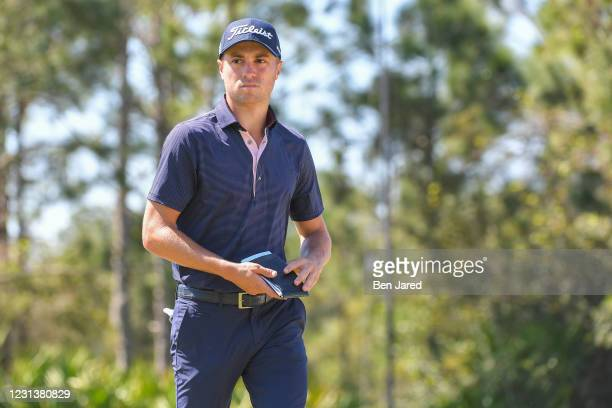 Justin Thomas walks off the 12th green uring the first round of the World Golf Championships-Workday Championship at The Concession on February 25,...