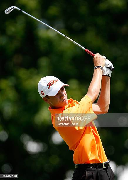 Justin Thomas watches a shot from the fairway on the 1st hole during the second round of the Wyndham Championship at Sedgefield Country Club on...