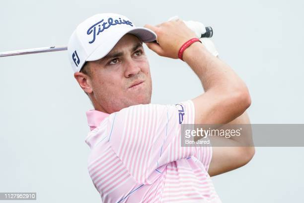 Justin Thomas watches his shot on the seventeenth hole tee box during the Honda Classic ProAm prior to The Honda Classic at PGA National Champion...