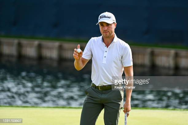 Justin Thomas waves his ball to fans on the 18th hole green during the third round of THE PLAYERS Championship on the Stadium Course at TPC Sawgrass...
