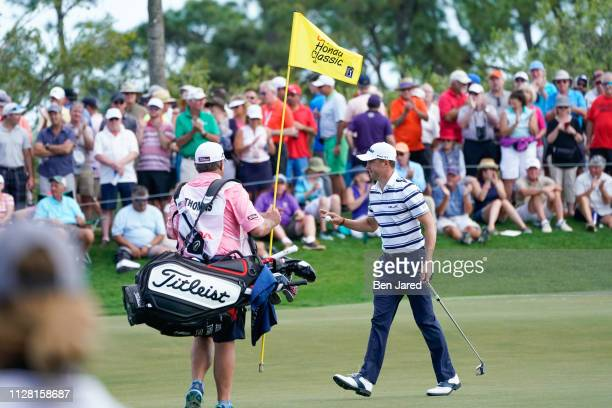 Justin Thomas waves to fans after making a putt on the sixth hole green during the first round of The Honda Classic at PGA National Champion course...