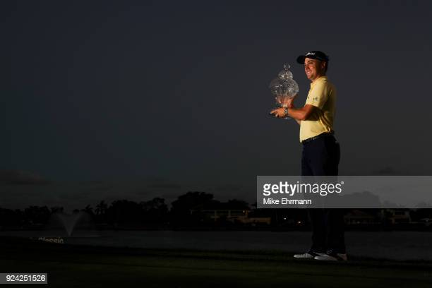 Justin Thomas with the winner's trophy after winning a playoff during the final round of the Honda Classic at PGA National Resort and Spa on February...