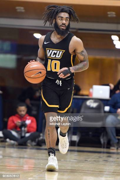 Justin Tillman of the Virginia Commonwealth Rams dribbles up court during a college basketball game against the George Washington Colonials at the...